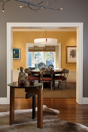 Contemporary Dining Room with Standard height, interior wallpaper, Casement, Crown molding, Wainscotting, Hardwood floors