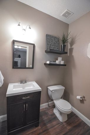 'Traditional Powder Room with Limestone counters, Livex Lighting Edgemont 2 Light Vanity Light, Undermount sink, High ceiling' from the web at 'http://photos2.zillowstatic.com/i_e/IS5anivqhcwo9x1000000000.jpg'