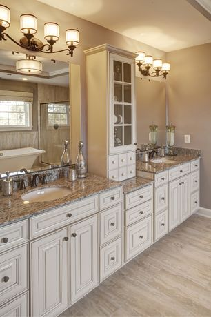 Traditional Master Bathroom with Complex granite counters, High ceiling, Crown molding, flush light, Double sink