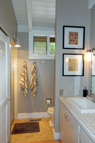 Cottage 3/4 Bathroom with Wall sconce, penny tile counters, Paint 1, Casement, drop-in sink, Raised panel, Louvered door