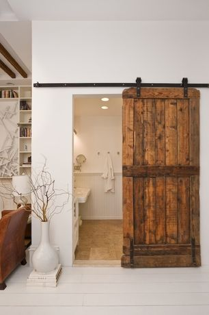 Rustic Master Bathroom with Barn door, Pedestal sink, Large white floor vase, Wainscotting, Pained wood floor, Raised ceiling