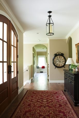 Traditional Entryway with Pendant light, Glass panel door, Standard height, Hardwood floors, Built-in bookshelf, can lights