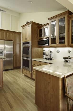 Traditional Kitchen with Oak - Winter White 2 1/4 in. Solid Hardwood Strip, Simple granite counters, Flat panel cabinets
