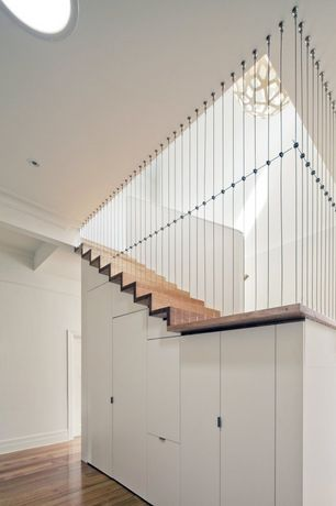 Contemporary Staircase with Hardwood floors, Chandelier, curved staircase, High ceiling