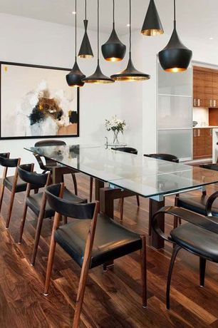 Contemporary Dining Room with Built-in bookshelf, Hardwood floors, can lights, Euro Style Shelly Expansion Dining Table