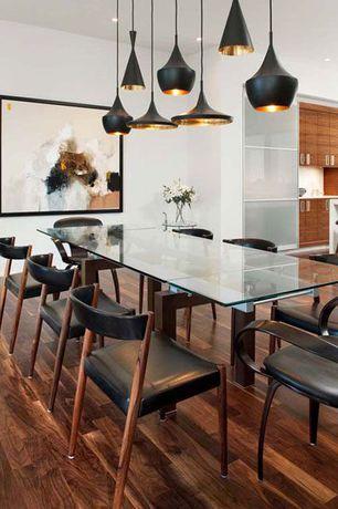 Contemporary Dining Room with Built-in bookshelf, Hardwood floors, Standard height, can lights, Pendant light