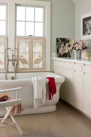 Contemporary Full Bathroom with Freestanding, Corian counters, Full Bath, Standard height, partial backsplash, Bathtub