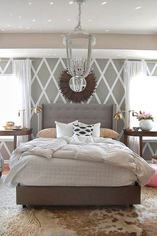 Eclectic Master Bedroom with Skyline - furniture wingback bed, Carpet, West Elm Cowhide Rug, Uttermost Vermundo Mirror