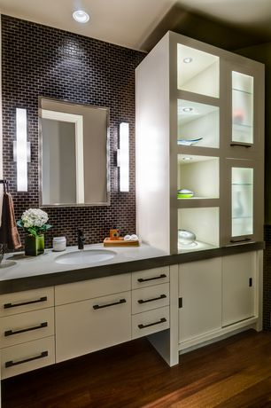 Contemporary Powder Room with Flush, Corian counters, Lin w1 wall sconce, European Cabinets, specialty door, Powder room