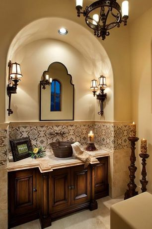 Mediterranean Powder Room with Wall sconce, stone tile floors, Raised panel, Arched window, can lights, Chandelier