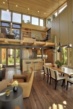 Contemporary Great Room with Loft, Pendant light, Built-in bookshelf, Hardwood floors, French doors, High ceiling