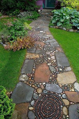 Eclectic Landscape/Yard with Raised beds, Pathway, Landecor Overlapping Rock Edger, This Old House Pebble Mosaic Tutorial