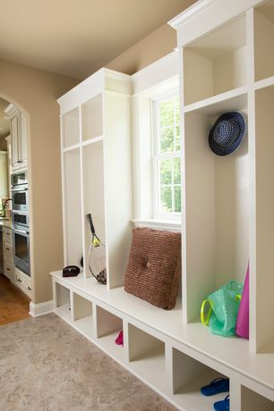 Traditional Mud Room with Built-in bookshelf, Window seat, double-hung window, complex marble tile floors, stone tile floors