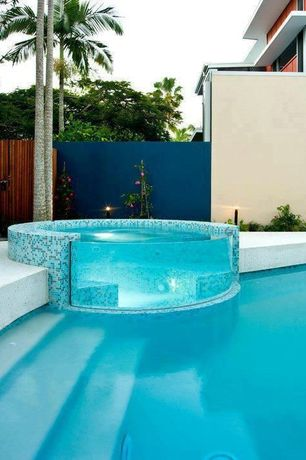 Contemporary Swimming Pool with Pool with hot tub, exterior concrete tile floors, exterior tile floors, Fence, Raised beds