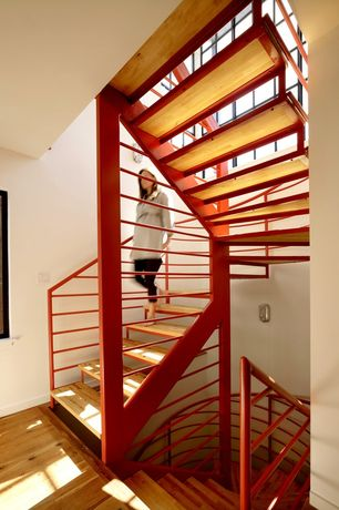 Contemporary Staircase with High ceiling, flush light, Hardwood floors, Metal staircase, picture window