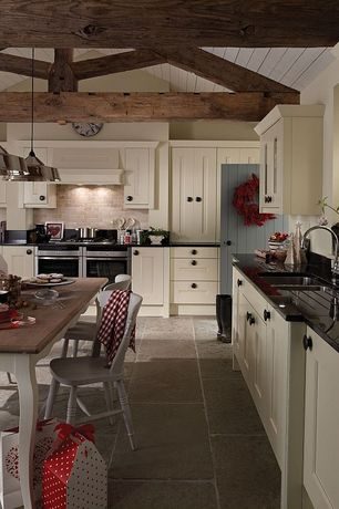 Country Kitchen with Flush, Limestone Tile, stone tile floors, double oven range, can lights, specialty door, Breakfast nook