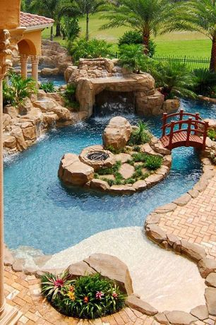 Tropical Swimming Pool with Brick pavers, Fence, Columns, Fountain, Water feature, exterior stone floors, Fire pit
