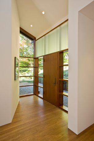 Contemporary Entryway with specialty window, Hardwood floors, Cathedral ceiling, Built-in bookshelf, can lights