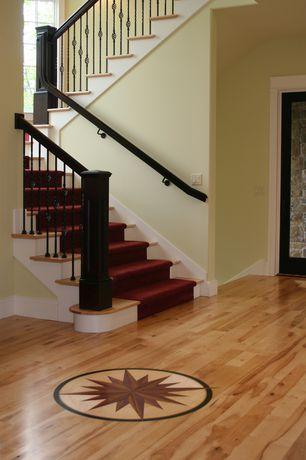 Traditional Entryway with Hardwood floors, specialty door, High ceiling