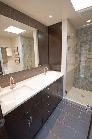 Contemporary 3/4 Bathroom with Handheld showerhead, frameless showerdoor, Skylight, Double sink, Simple granite counters