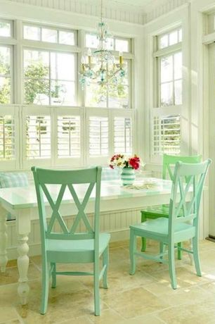 Cottage Dining Room with Chandelier, double-hung window, Crown molding, French doors, Standard height, Transom window
