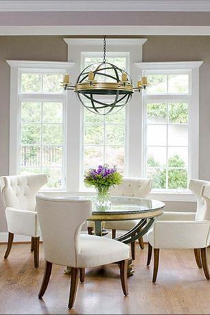 Eclectic Dining Room with Standard height, Wall sconce, Chandelier, Crown molding, picture window, Hardwood floors