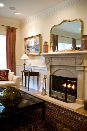 Traditional Living Room with Crown molding, Cyan design mystic gold fire screen, Built-in bookshelf, can lights, Chair rail