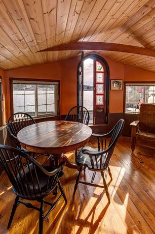 Craftsman Dining Room with Hardwood floors, French doors, Exposed beam