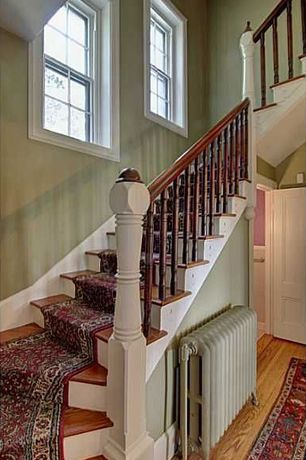 Traditional Staircase with High ceiling, Hardwood floors