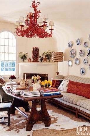 Eclectic Dining Room with Carpet, Cement fireplace, 1960's Coral Iron Chandelier, Chandelier, Arched window