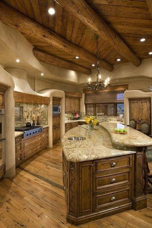 Rustic Kitchen with Viking prostyle gas rangetop, U-shaped, Kitchen island, Chandelier, Custom hood, High ceiling