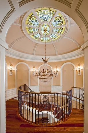 Traditional Staircase with Crown molding, Wainscotting, Wall sconce, High ceiling, Chandelier, Hardwood floors