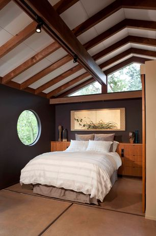 Asian Master Bedroom with limestone tile floors, Cathedral ceiling, Built-in bookshelf, Exposed beam, specialty window