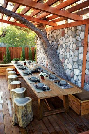 Rustic Deck with New Pacific Direct Tree Stump Low Stool, Fence, Raised beds, Coolaroo Indoor/Outdoor Placemat, Trellis