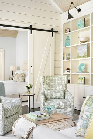 Cottage Living Room with Handy living andee greek key chair, apple green, Built-in bookshelf, Barn door, High ceiling