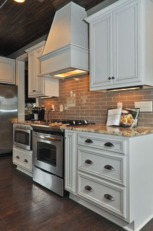 Traditional Kitchen with Flat panel cabinets, One-wall, Complex granite counters, Custom hood, Subway Tile