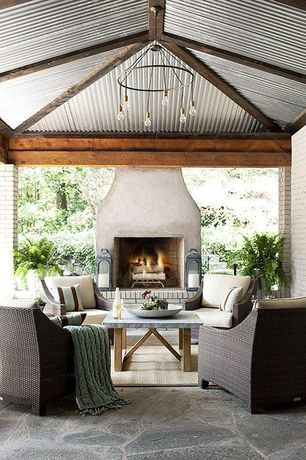 Eclectic Porch with Outdoor fireplace, Modena chair set with ivory cushions, Covered porch, exterior stone floors