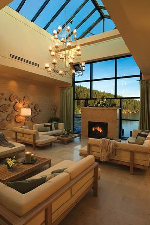 Contemporary Living Room with interior wallpaper, High ceiling, Skylight, Chandelier, stone fireplace, Exposed beam