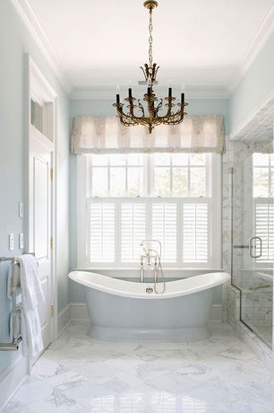 Contemporary Master Bathroom with Plantation shutters, Crown molding, Free standing bath faucet, complex marble tile floors