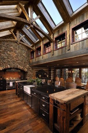 Rustic Kitchen with Flat panel cabinets, Subway Tile, One-wall, Flush, Soapstone counters, Custom hood, Skylight, flush light