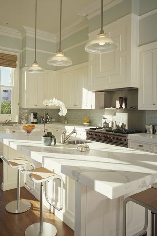 Contemporary Kitchen with Wall Hood, Undermount sink, Flat panel cabinets, full backsplash, gas range, Crown molding, Paint