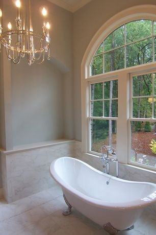 Traditional Master Bathroom with Master bathroom, stone tile floors, Arched window, Chandelier, Paint, Standard height