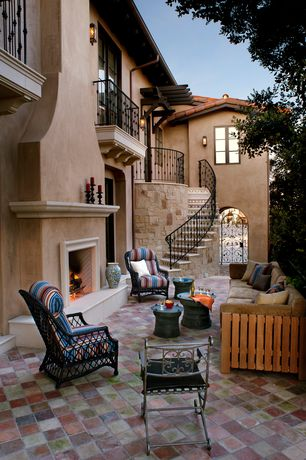 Mediterranean Patio with Sunset pier dining chair - chestnut brown, French doors, Exterior fireplace, Arched doorway