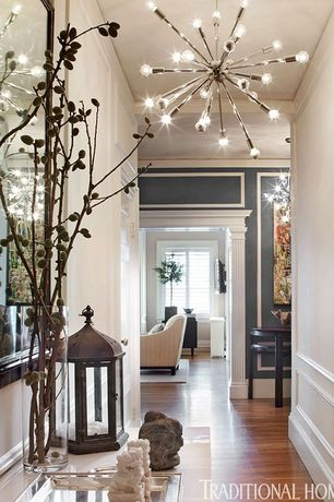 Eclectic Hallway with Spark 24-light chrome hanging chandelier, High ceiling, Hardwood floors, Chandelier, Wainscotting