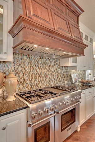 Traditional Kitchen with Hardwood floors, Custom hood, Daltile blanc et beige rain drop da20, Raised panel