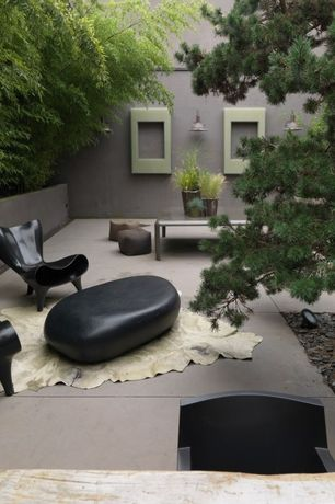Contemporary Patio with exterior tile floors, Raised beds, exterior concrete tile floors