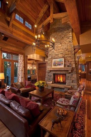 Rustic Living Room with Transom window, Sunken living room, stone fireplace, High ceiling, Chandelier, Built-in bookshelf