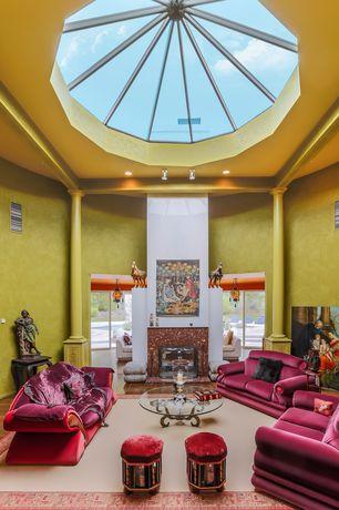 Eclectic Living Room with High ceiling, Exposed beam, Hardwood floors, Columns, Skylight, flush light