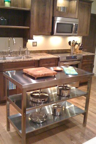 Modern Kitchen with Stainless steel counters, Inset cabinets, built-in microwave, Kitchen island, dishwasher, Complex Granite