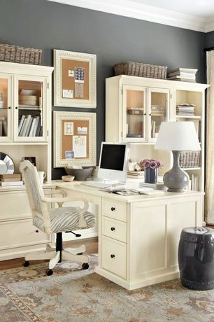 Traditional Home Office with Animal print chair upholstery, Standard height, Hardwood floors, Framed pinboards, Hutch, Paint